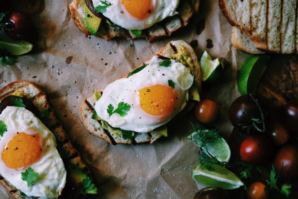 spanish-fried egg, smashed avocado + heirloom tomato toast